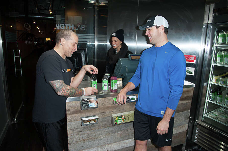 Mark Teixeira, right, Yankee first baseman and a Greenwich resident, and an investor in Juice Press, shares a conversation with Marcus Antebi, Juice Press CEO, behind the scenes at one of the company's restaurants. Photo: DAVE KOTINSKY, Greenwich Time Contributed / Greenwich Time contributed