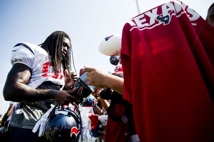 Houston Texans linebacker Jadeveon Clowney signs autographs during Texans training camp at the Metho