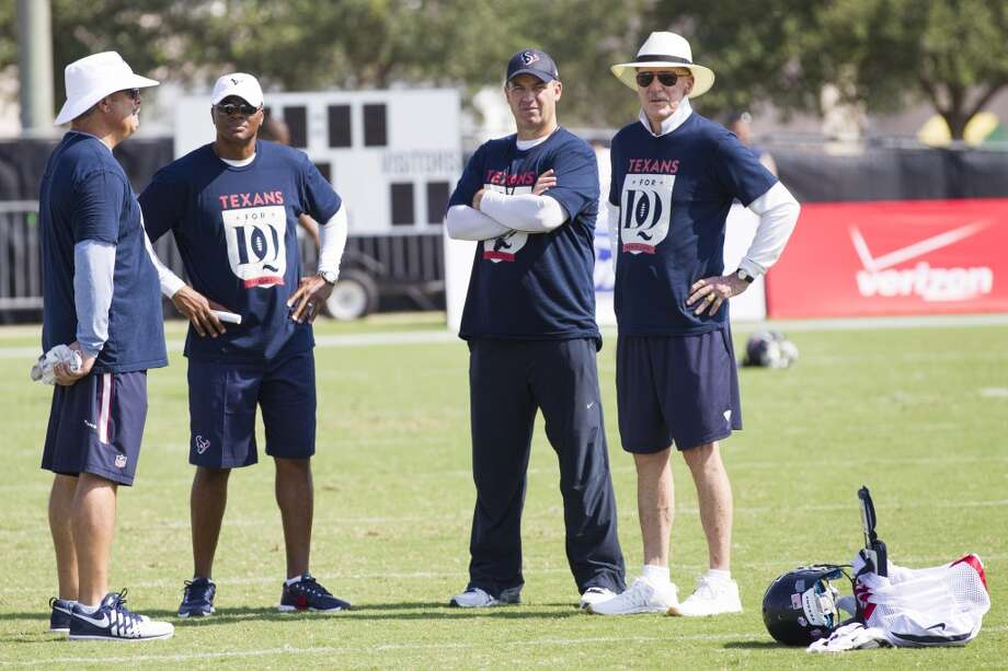 Cal McNair, Texans COO, left, Rick Smith, general manager, Bill O'Brien, head coach, and Bob McNair, owner, stand on the field after a joint practice. Photo: Brett Coomer, Houston Chronicle