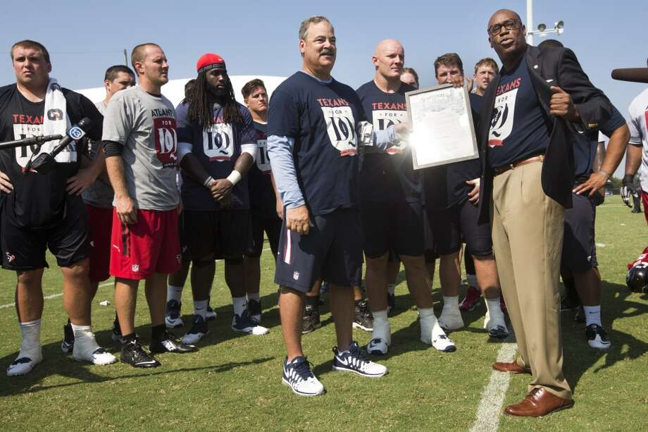 "Texans COO Cal McNair accepts a ""Texans for DQ Day"" proclamation from Houston City Councilman Larry Greene following practice. ""Texans for DQ Day"" honors Texans offensive tackle David Quessenberry who is battling lymphoma. Photo: Brett Coomer, Houston Chronicle"