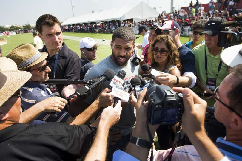 Texans running back Arian Foster speaks to the media after practice.