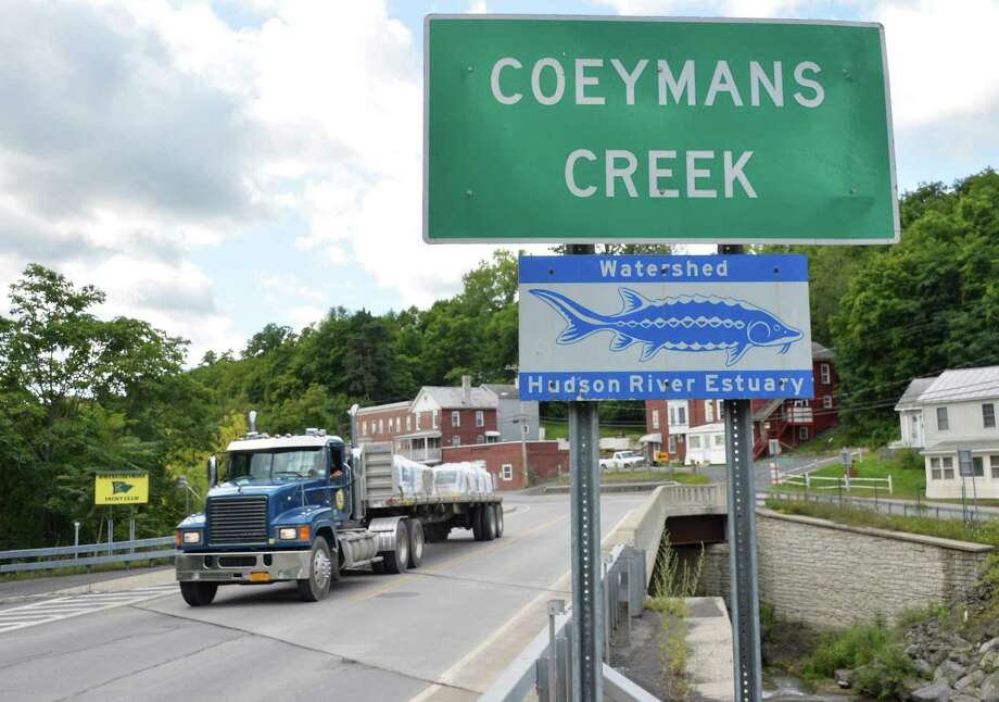 A truck makes its way around a hairpin turn on River Road in Coeymans Thursday Aug. 14, 2014, in Coeymans, N.Y. Work has begun on a new bridge to aid traffic in the area.  (John Carl D'Annibale / Times Union) Photo: John Carl D'Annibale / 00028173A