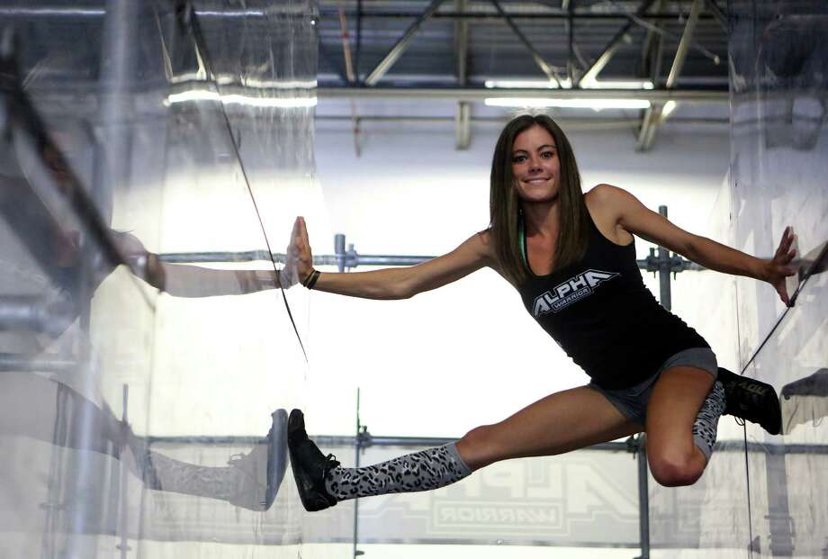 "Kacy Catanzaro, the 5-feet-tall woman who made history on ""American Ninja Warrior"" and who went viral earlier in the month, lives and trains in San Antonio with her boyfriend and fellow Ninja, Brent Steffensen. Photo: Helen L. Montoya, San Antonio Express-News / ©2014 San Antonio Express-News"