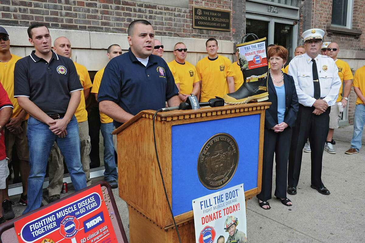 Justin Gershon, MDA representative Albany Permanent Professional Firefighters Association Local 2007, speaks during a kickoff for the firefighters' annual Fill the Boot fundraising campaign to benefit Muscular Dystrophy Association at the New York State Professional Fire Fighters Association Building on Thursday, Aug. 14, 2014 in Albany, N.Y. (Lori Van Buren / Times Union)