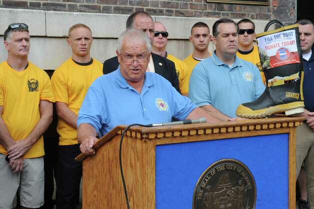 New York State Professional Fire Fighters Association President Michael McManus speaks during a kickoff for the firefighters' annual Fill the Boot fundraising campaign to benefit Muscular Dystrophy Association at the New York State Professional Fire Fighters Association Building on Thursday, Aug. 14, 2014 in Albany, N.Y. (Lori Van Buren / Times Union) Photo: Lori Van Buren / 00028108A