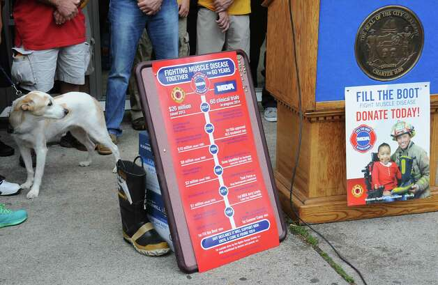Signs are seen at a kickoff for the firefighters' annual Fill the Boot fundraising campaign to benefit Muscular Dystrophy Association at the New York State Professional Fire Fighters Association Building on Thursday, Aug. 14, 2014 in Albany, N.Y. (Lori Van Buren / Times Union) Photo: Lori Van Buren / 00028108A