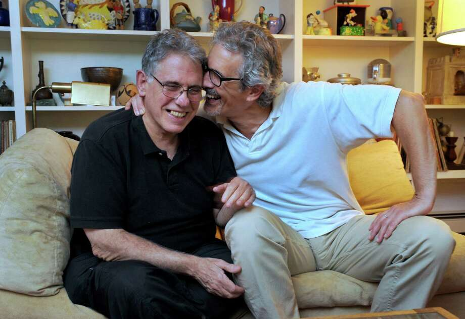 Ken Cornet, left, and Joe Mustich have been together since 1979. They entered into a civil union in 2005 and were legally married in 2008. They are shown here in their Washington, Conn., home. Photo: Carol Kaliff / The News-Times
