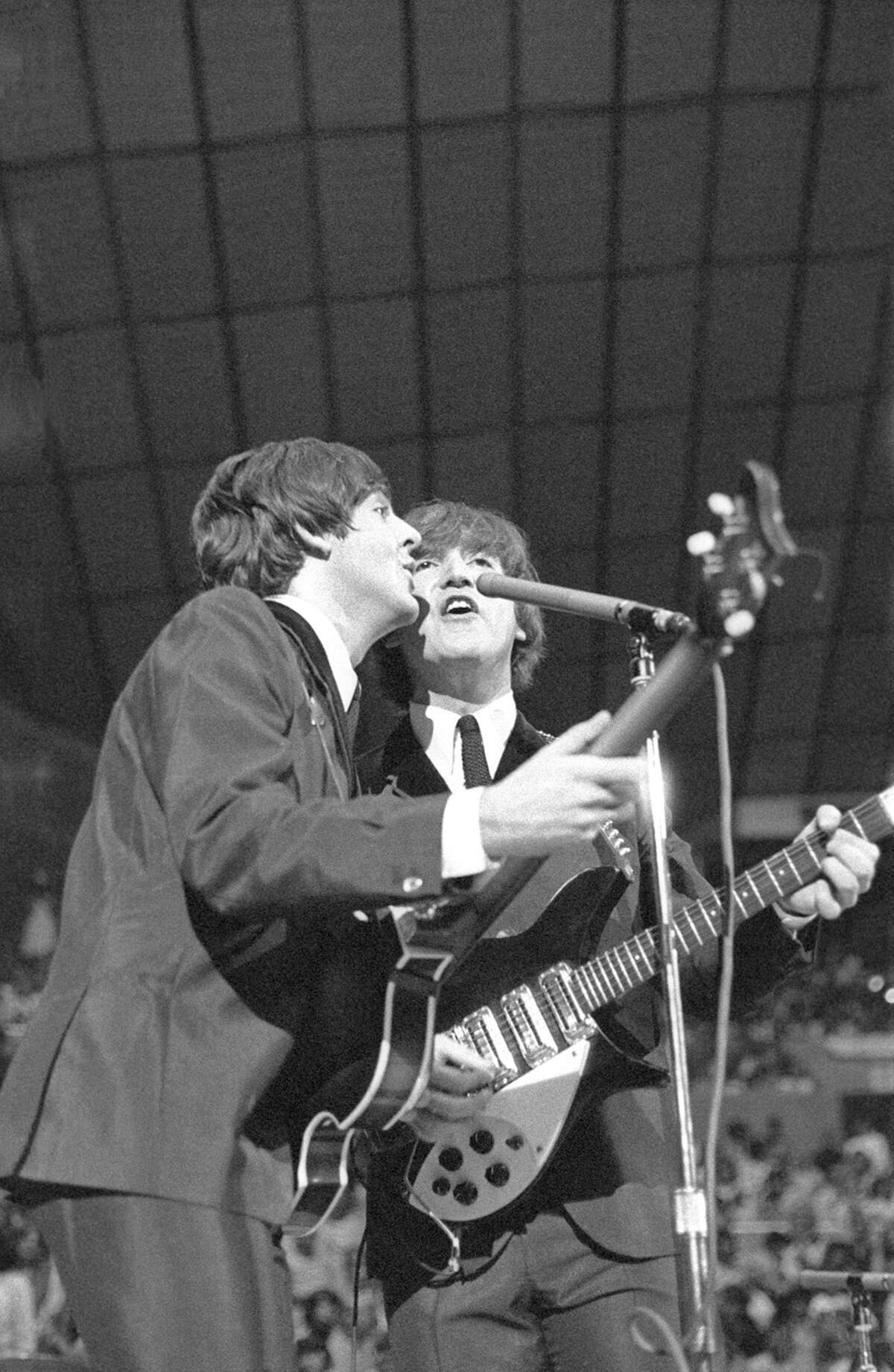 The Beatles play their first concert in Seattle, August 21, 1964 at the Seattle Center Coliseum. This image is part of a MOHAI pop-up display commemmorating the 50th anniversary of the Beatles' first Northwest visit.