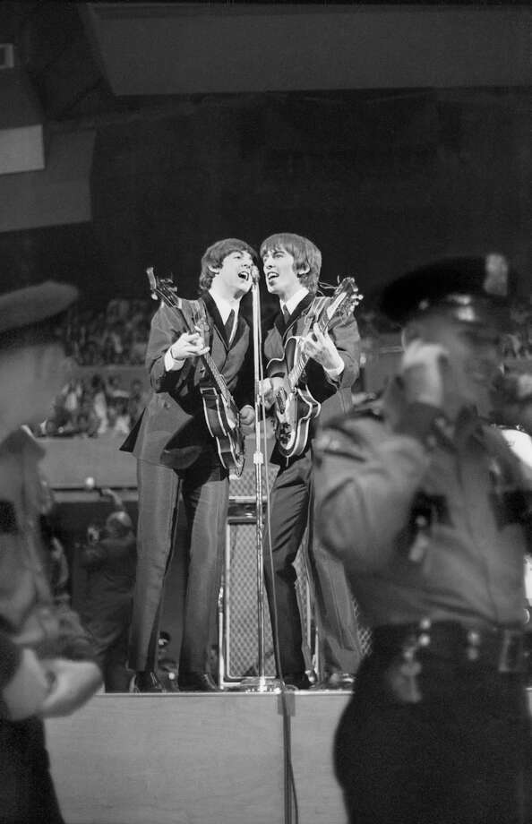 The Beatles play their first concert in Seattle, August 21, 1964 at the Seattle Center Coliseum Photo: Timothy Eagan, MOHAI,  Timothy Eagan Collection / Copyright Timothy Eagan Collection, Museum of History & Industry