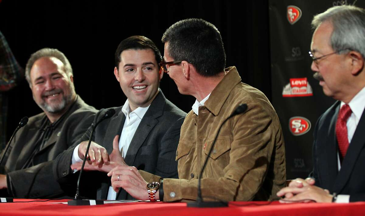 Jed York, CEO of the San Francisco 49ers, second from left, shakes hands with Chip Bergh, CEO of Levi Strauss & company, as Jamie Matthews, mayor of Santa Clara ,and Ed Lee, mayor of San Francisco, look on. The group announced a proposed partnership for the naming rights for the new stadium now under construction in Santa Clara, Wednesday, May 8, 2013, in San Francisco, California.