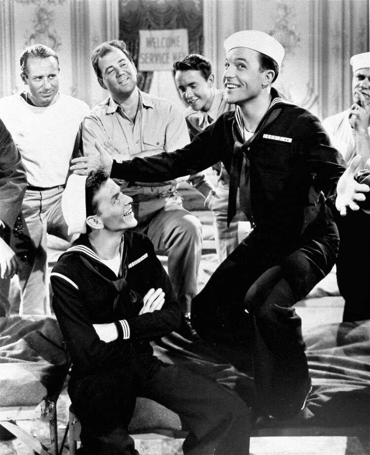 """FILE - This 1950 file photo originally released by MGM shows Gene Kelly, right, and Frank Sinatra in a scene from """"On the Town."""" The lead producers behind the 1940s song-and-dance Broadway revival of """"On the Town"""" are offering accredited folk an opportunity to invest in the production for as little as $10,000. """"On the Town,"""" which was last on Broadway in 1998,  features the songs """"New York, New York,"""" """"I Can Cook Too,"""" """"Lonely Town,"""" and """"Some Other Time."""" (AP Photo, File) Photo: Associated Press"""