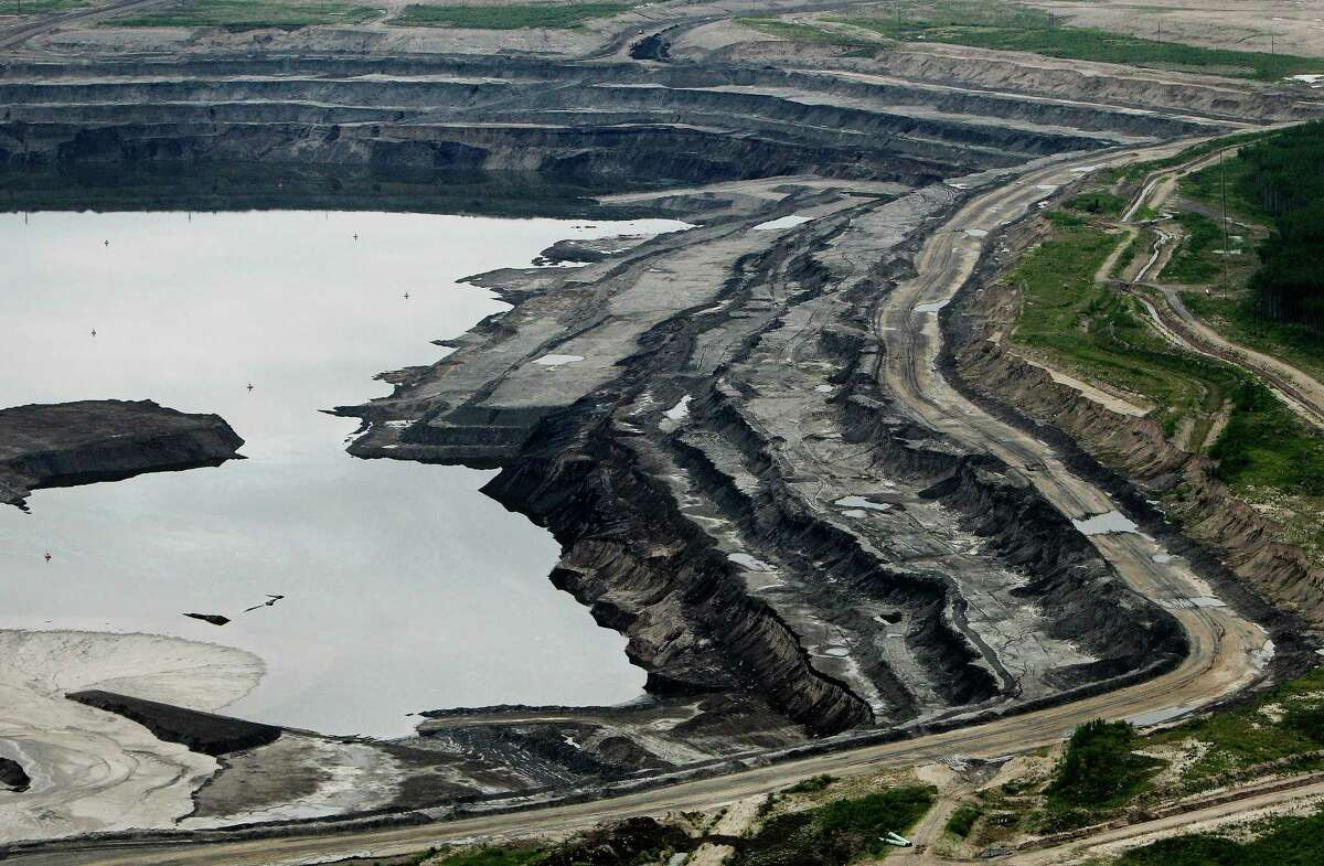 The Syncrude Canada mine in the Athabasca Oil Sands near Fort McMurray, Alberta. The main operator, Canadian Oil Sand Ltd, has cut its dividend 16 percent due to low oil prices.