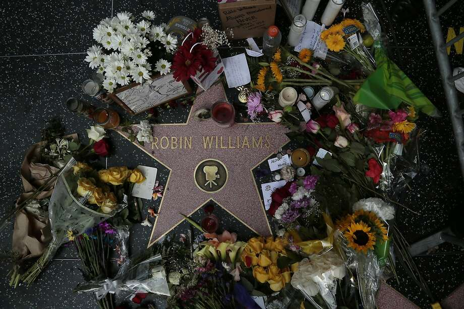 Flowers and memorabilia are piled on the late Robin Williams' Hollywood Walk of Fame star in Los Angeles on Tuesday. Photo: Robert Gauthier, McClatchy-Tribune News Service