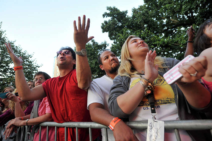 Elliot Goldberg, left, Lewis McRea, center, and his girlfriend, Christina Trotto, watch The Beach Boys perform during Alive@Five in Columbus Park in Stamford, Conn., on Thursday, Aug. 14, 2014. Hearst Connecticut Media Group is a sponsor of the event.