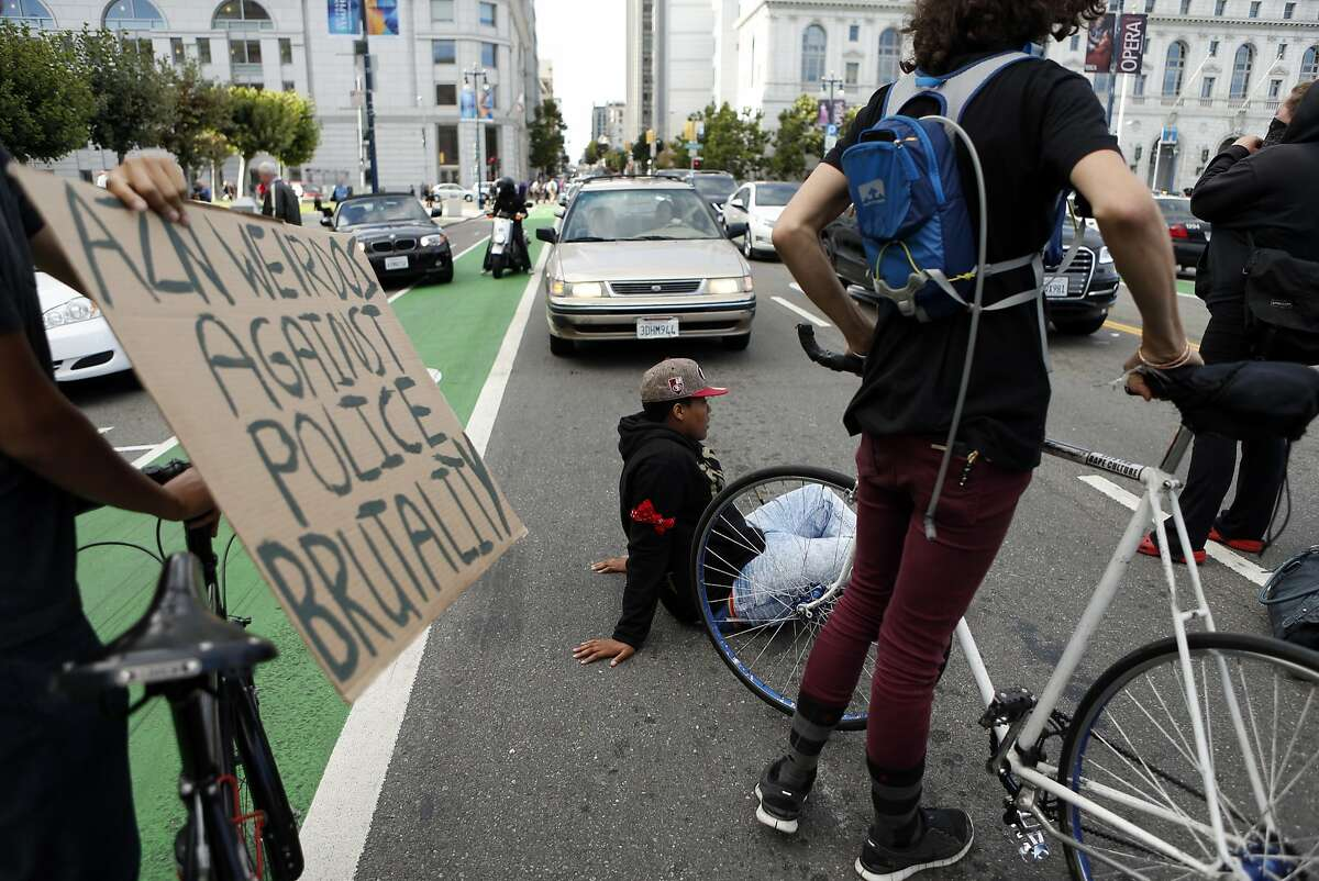 Protesters block the street in front of City Hall after a national moment of silence for victims of police brutality at Civic Center in San Francisco, Calif. on Tuesday, August 14, 2014.
