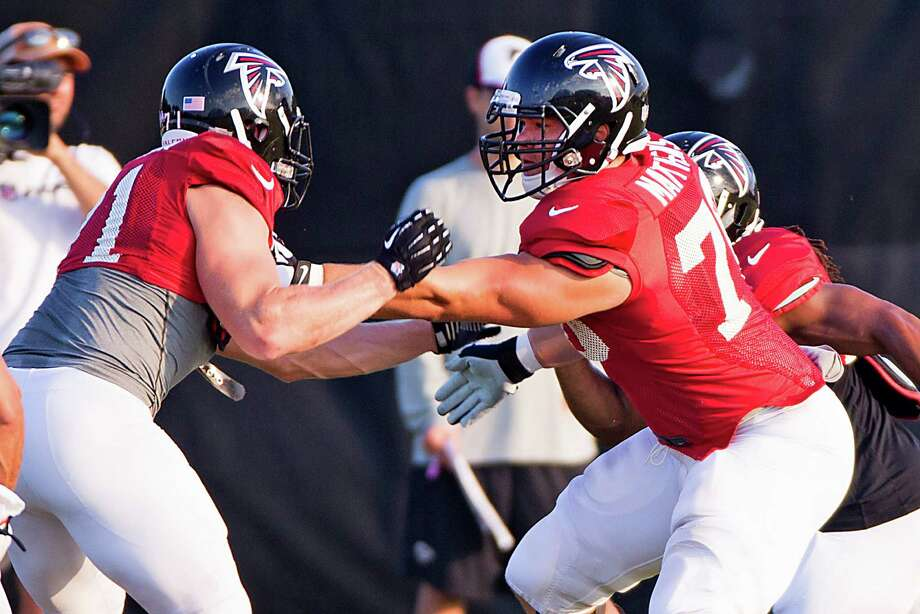 Falcons offensive tackle Jake Matthews, right, enjoys spending some of his first NFL camp near his football roots in Texas. Photo: Brett Coomer, Staff / © 2014 Houston Chronicle