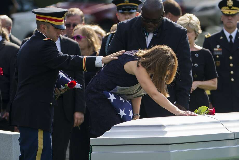 Army Lt. Matthew Greene comforts his mother, retired Col. Susan Myers, at the funeral  of his father, Army Maj. Gen. Harold Greene, during a service at Arlington National Cemetery. Photo: Evan Vucci, Associated Press