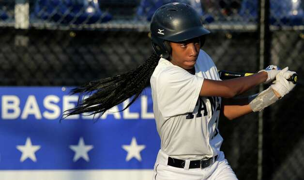 FILE - In this Aug. 6, 2014, file photo, Pennsylvania's Mo'ne Davis follows through on a single against the District of Columbia during a baseball game in the Little League Eastern Regionals at Breen Stadium in Bristol, Conn. Two girls will be competing at the same time for just the third time in the Little League World Series' 68-year history. But unlike many of the 16 girls that have preceded them, there's a future for Philadelphia's Mo'ne Davis and Canada's Emma March to pitch beyond the fields of Williamsport, Pennsylvania.(AP Photo/Charles Krupa, File) ORG XMIT: NY166 Photo: Charles Krupa / AP
