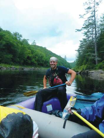 Photo by Gillian Scott. Shane Piller, a whitewater guide with Beaver Brook Outfitters, on the Hudson River.