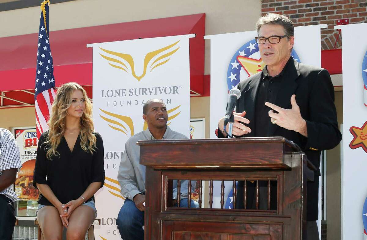 Swimsuit model and Texas native Hannah Ferguson and Rocky Stubblefield of Stubb's BBQ listen last week in Austin as Gov. Rick Perry thanks Carl's Jr. for its commitment to Texas veterans.