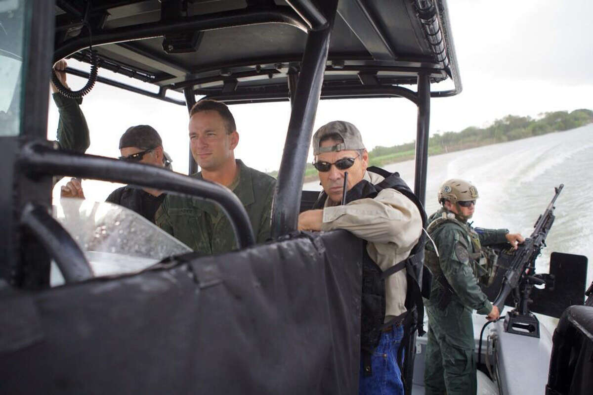Governor Rick Perry on the Texas-Mexico border with Texas DPS on July 10, 2014.