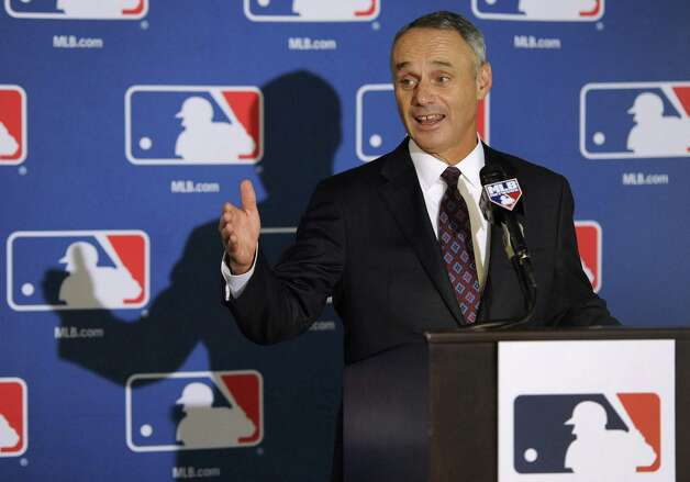 Major League Baseball Chief Operating Officer Rob Manfred speaks to reporters after team owners elected him as the next commissioner of Major League Baseball during an owners quarterly meeting in Baltimore, Thursday, Aug. 14, 2014. (AP Photo/Steve Ruark) ORG XMIT: MDSR102 Photo: Steve Ruark / FR96543 AP