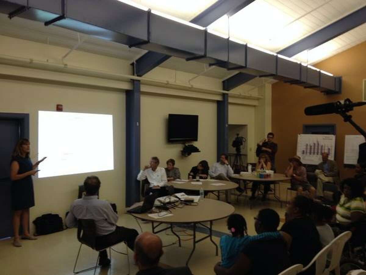 A community meeting at Ezra Prentice Homes in Albany on Thursday, Aug. 14, 2014, where the Department of Environmental Conservation said air quality testing showed