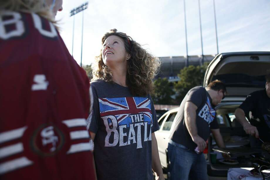 "Jamie Garrison of San Jose, a longtime 49ers season ticket holder, tailgates in her family's ""spot"" before the start of Paul McCartney's farewell show at Candlestick Park on Thursday Aug. 14, 2014 in San Francisco, Calif. Photo: Mike Kepka"