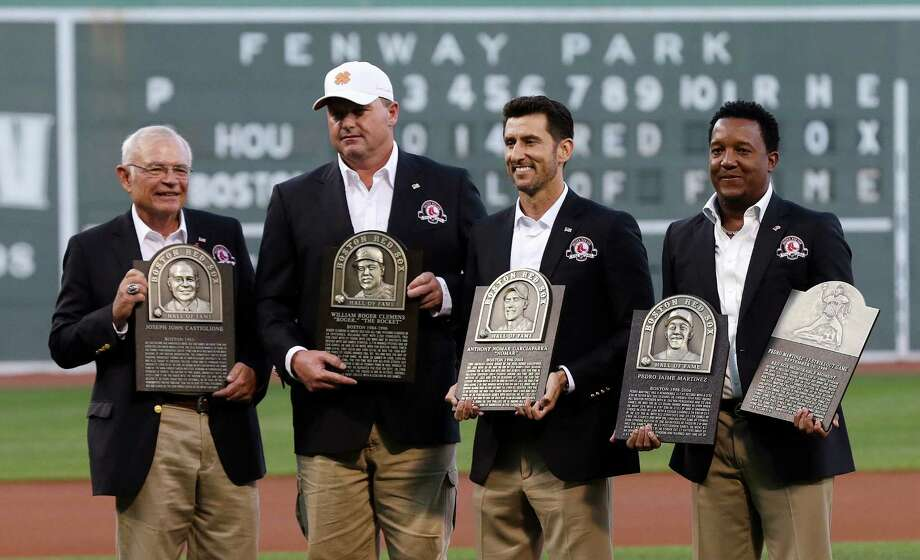 Boston Red Sox broadcaster Joe Castiglione, left, stands with team greats Roger Clemens, Nomar Garciaparra and Pedro Martinez, from left, with their plaques prior to a game at Fenway Park in Boston, Thursday, Aug. 14, 2014. Castiglione, Clemens, Garciaparra and Martinez were inducted into the Boston Red Sox Hall of Fame earlier in the day. (AP Photo/Charles Krupa) ORG XMIT: MACK102 Photo: Charles Krupa / AP