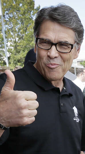 Thanked for attending an Iowa State Fair political soapbox, Texas Gov. Rick Perry replied as he came