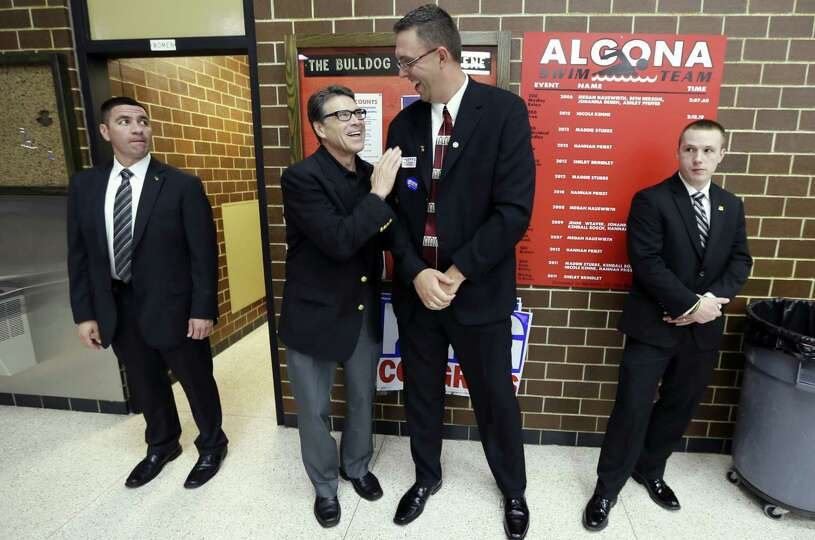 During a meeting with local GOP activists in Algona, Iowa, Texas Gov. Rick Perry looks up to share a