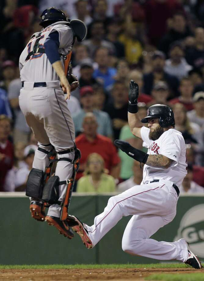 Houston catcher Jason Castro prepares to tag Boston's Mike Napoli out at the plate in the fourth inning at Fenway Park. Photo: Charles Krupa / Associated Press / AP