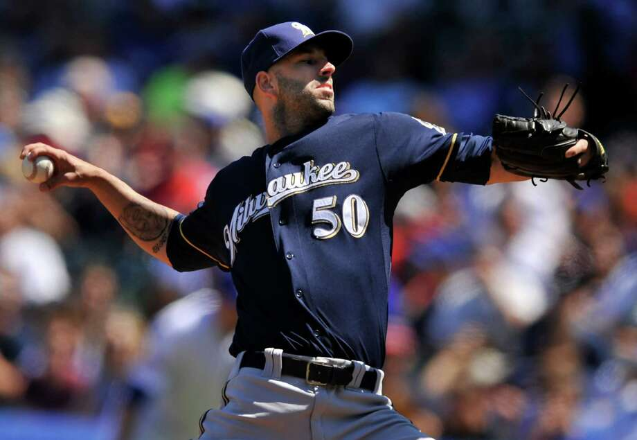 What Mike Fiers delivered, the Cubs couldn't hit Thursday. The Brewers righthander struck out 14 batters in six innings while allowing only three hits. Photo: PAUL BEATY, FRE / FR36811 AP