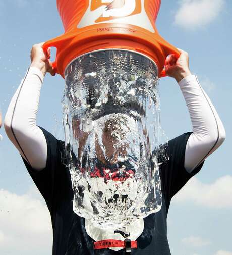 Texans coach Bill O'Brien was not one to shirk the ALS Ice Bucket Challenge when the opportunity presented itself after practice Thursday. Photo: Brett Coomer, Staff / © 2014 Houston Chronicle
