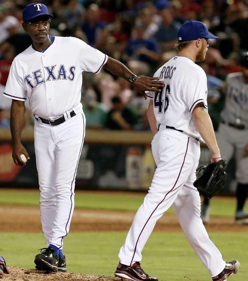 Texas Rangers manager Ron Washington, left, relieves starting pitcher Robbie Ross Jr. (46) during the fifth inning of a baseball game against the Tampa Bay Rays, Thursday, Aug. 14, 2014, in Arlington, Texas. (AP Photo/Brandon Wade) Photo: Brandon Wade, Associated Press / FR168019 AP