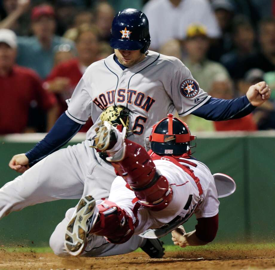 Red Sox catcher Christian Vazquez tags out Astros outfielder Jake Marisnick, who tried to score on a fly out to right field by Jose Altuve during the seventh inning Thursday at Fenway Park in Boston. Photo: Charles Krupa, STF / AP