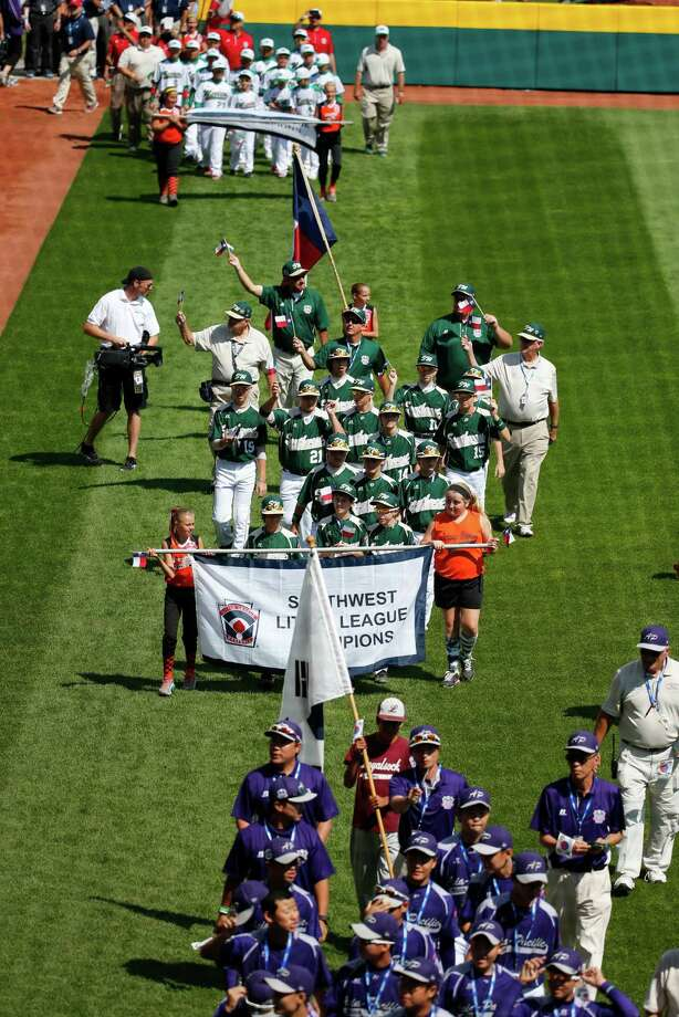 The Pearland East Little League baseball team from Pearland, Texas, center,  participates in the opening ceremony of the 2014 Little League World Series tournament in South Williamsport, Pa., Thursday, Aug. 14, 2014. (AP Photo/Gene J. Puskar) Photo: Gene Puskar, Associated Press / AP