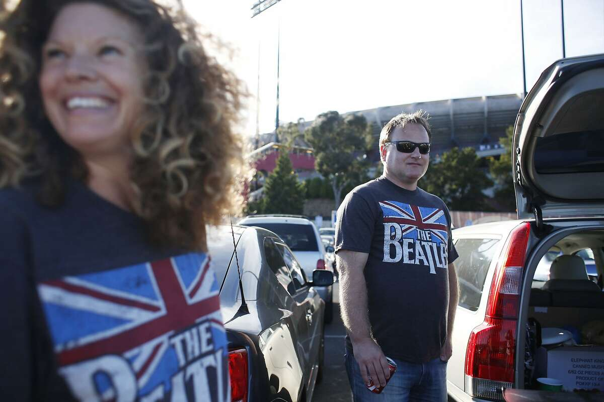 """Jamie Garrison and Jack Earl, long-time 49ers season ticket holders, of San Jose, tailgate in """"their spot"""" before the start of Paul McCartney's farewell show at Candlestick Park on Thursday Aug. 14, 2014 in San Francisco, Calif."""