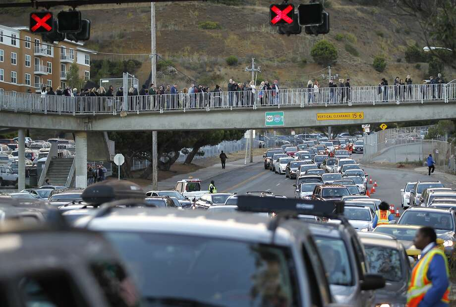 A crush of vehicles inches toward Candlestick's parking lots. Some ticketholders gave up on getting to see Paul McCartney. Photo: Leah Millis, The Chronicle