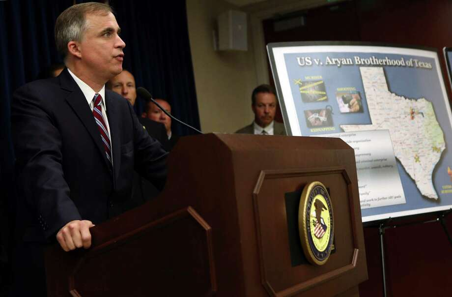 (left to right) David M. Marwell, Special Agent in Charge Homeland Security Investigations-Dallas Field Division, participate in a press conference to announce significant activity regarding the Aryan Brotherhood of Texas on Wednesday, Aug. 13, 2014, in Houston. Photo: Mayra Beltran, Houston Chronicle / © 2014 Houston Chronicle