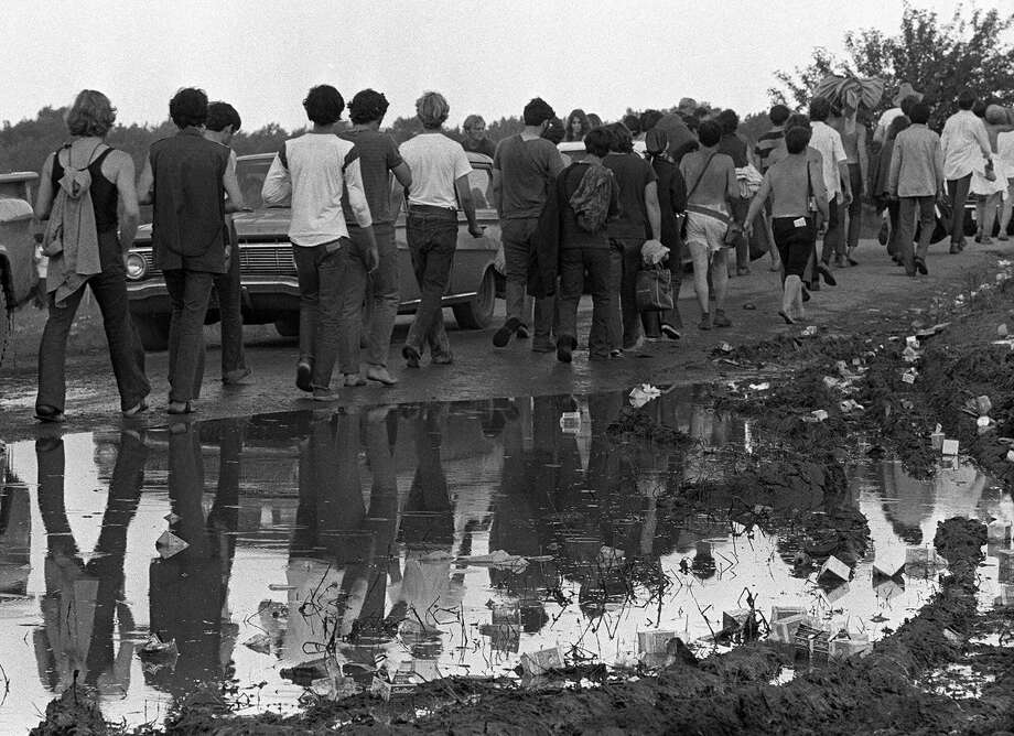 Woodstock Music and Art Festival participants leave the festival on Aug. 17, 1969 in Bethel, N.Y.  (AP Photo) Photo: ASSOCIATED PRESS / AP1969