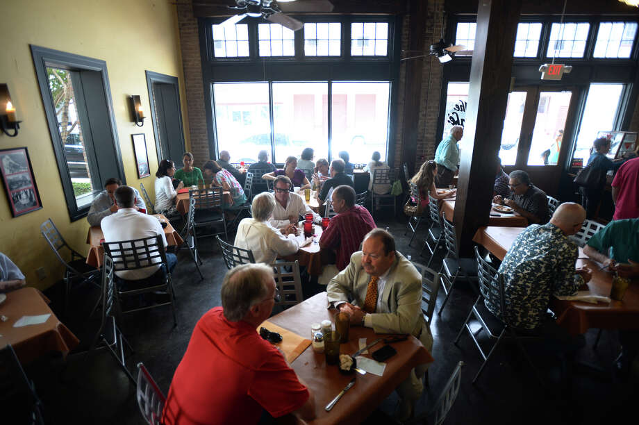 Guests enjoy lunch and conversation at the Cafe in downtown Beaumont on Thursday. The Cafe is expected to close by the end of the month. Photo taken Thursday, August 14, 2014 Guiseppe Barranco/@spotnewsshooter Photo: Guiseppe Barranco, Photo Editor