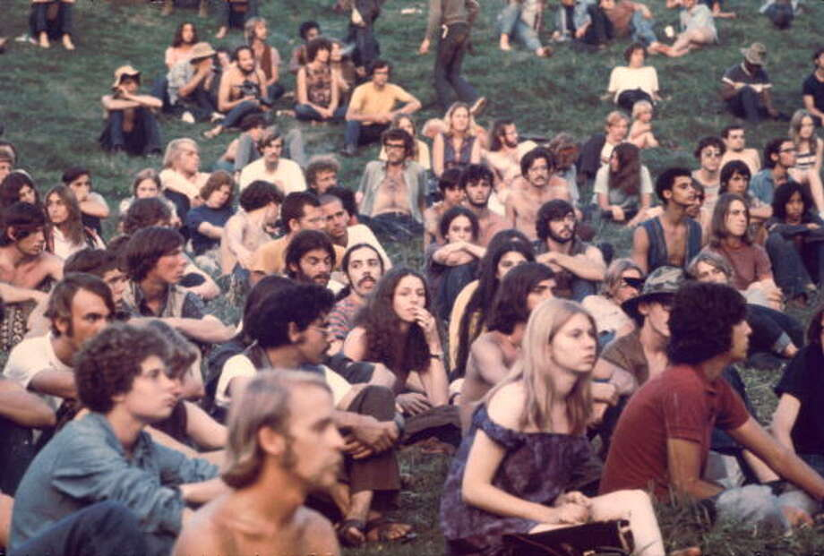 View of a portion of the audience as they watch a performance at the Woodstock Music and Arts Fair, Bethel, New York, August 1969. The festival ran from August 15 to 18. Photo: Ralph Ackerman, (Getty Images) / Hulton Archive