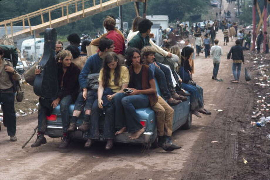 Hippies catching a ride on a car at Woodstock, Bethel, New York State, August 1969. Photo: Bill Eppridge, (Getty Images) / 2009 Getty Images