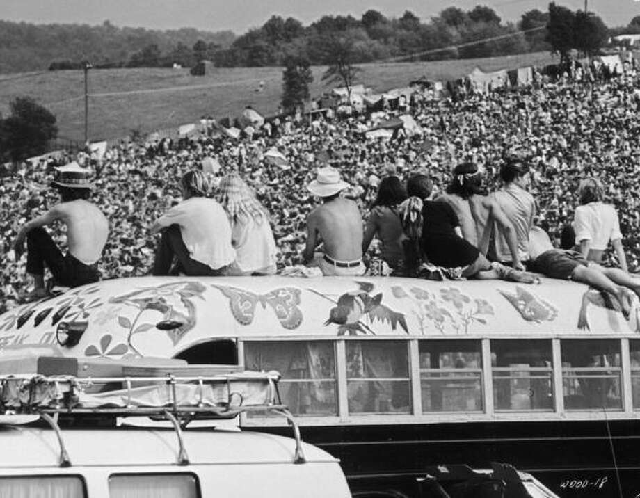 Fans sitting on top of a painted bus at the Woodstock Music Festival, Bethel, New York, 15th-17th August 1969. Photo: Archive Photos, (Getty Images) / 2009 Getty Images