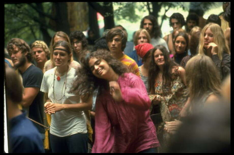 Psylvia, dressed in a pink Indian shirt, dancing in midst of the crowd, during Woodstock Music & Art Festival. Photo: Bill Eppridge, (Getty Images) / Time Life Pictures