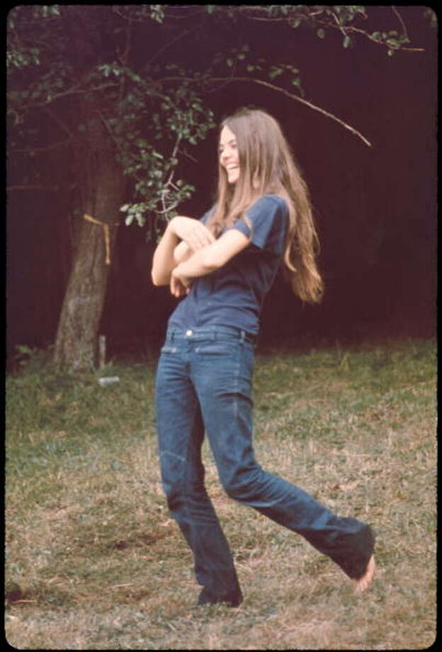 Long-haired, barefoot laughing young woman at the Woodstock music festival, August 1969. Photo: Ralph Ackerman, Getty Images / Copyright 2009 Patricia Freed Ackerman