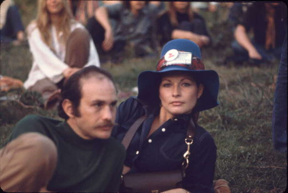 A man and woman lie on the grass during a performance on the 'Free Stage' at the Woodstock Music and Arts Fair, Bethel, New York, August 1969. The 'Free Stage' essentially functioned as both a place from the scheduled performers to jam and as an open mic stage for festival goers. The festival ran from August 15 to 18. Photo: Ralph Ackerman, Getty Images / Hulton Archive