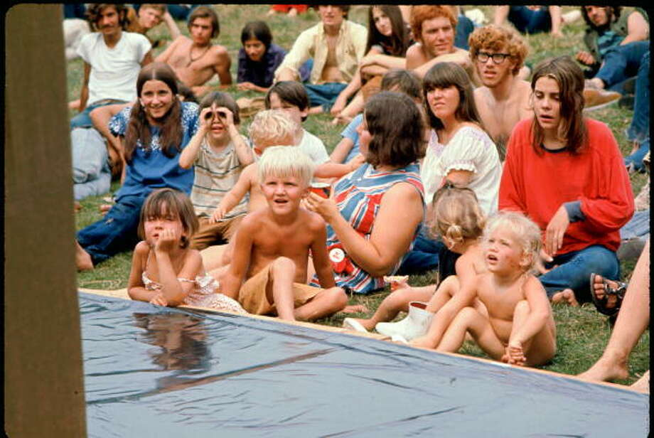 Merry Prankster and Hog Farmer kids watch puppet show at the Free Stage at the Woodstock music festival, August 1969. Photo: Ralph Ackerman, Getty Images / Copyright 2009 Patricia Freed Ackerman