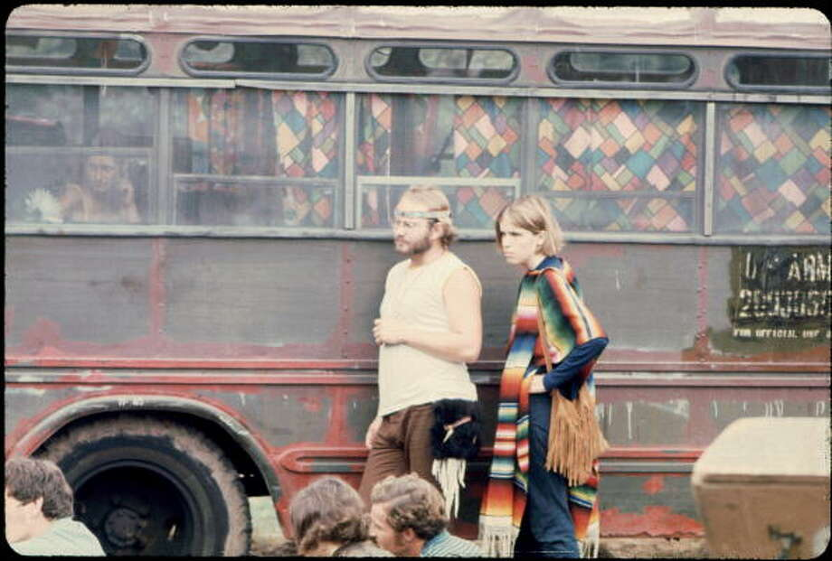 People outside one of the buses the Hog Farmers drove from New Mexico, at the Woodstock music festival, August 1969. Photo: Ralph Ackerman, Getty Images / Copyright 2009 Pat Ackerman